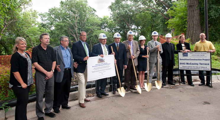 A host of firms and individuals are working together to build the home in Edina. Many of them were on hand for the groundbreaking at the constuction site Tuesday, July 9. From the left are Stephanie Angen, JMS Custom Homes; Scott Whitworth, JMS Custom Homes; Jeff Schoenwetter, JMS Custom Homes; John Everett, Edina Realty; Bob Strachota, Shenehon Co.; James Gooley, St. Thomas Development Office; Herb Tousley, St. Thomas real estate programs; Teresa Lingg, St. Thomas real estate student; Ted Johnson, St. Thomas real estate student; Father John Malone, St. Thomas Office for Mission; Nancy Schoenwetter, JMS Custom Homes; and Matt Hannish, JMS Custom Homes.