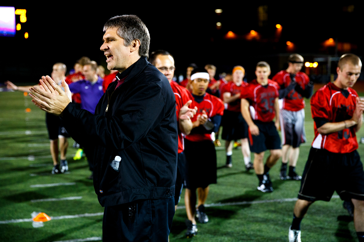 SJV rector Fr. Michael Becker claps for his team. (Photo by Mike Ekern '02)