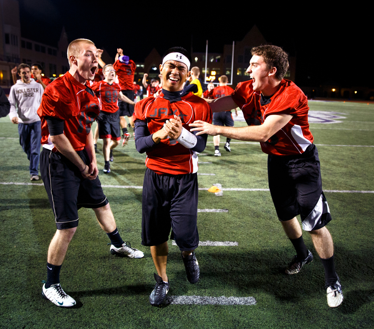 From left: SJV seminarians Greg Parent, Vince Fernandez, and James Smyth celebrate a touchdown. (Photo by Mike Ekern '02)