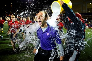 SJV head coach Nathanial Binversie gets a victory shower from his team. (Photo by Mike Ekern '02)