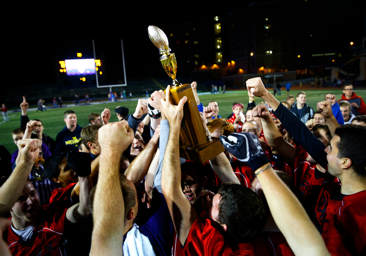 The SJV JAXX hoist the Rectors' Cup, having defeated the graduate seminarians 19-12. (Photo by Mike Ekern '02)