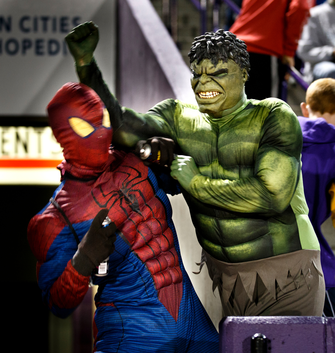 The Hulk and Spiderman fight for their favorite teams. (Photo by Mike Ekern '02)