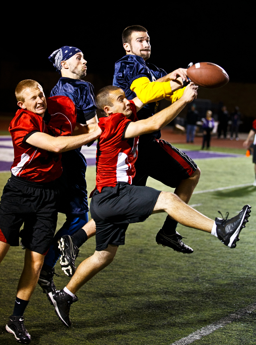 Sons of Thunder (in blue) and JAXX team members fight for a pass during the 14th annual Rectors' Bowl. (Photo by Mike Ekern '02)