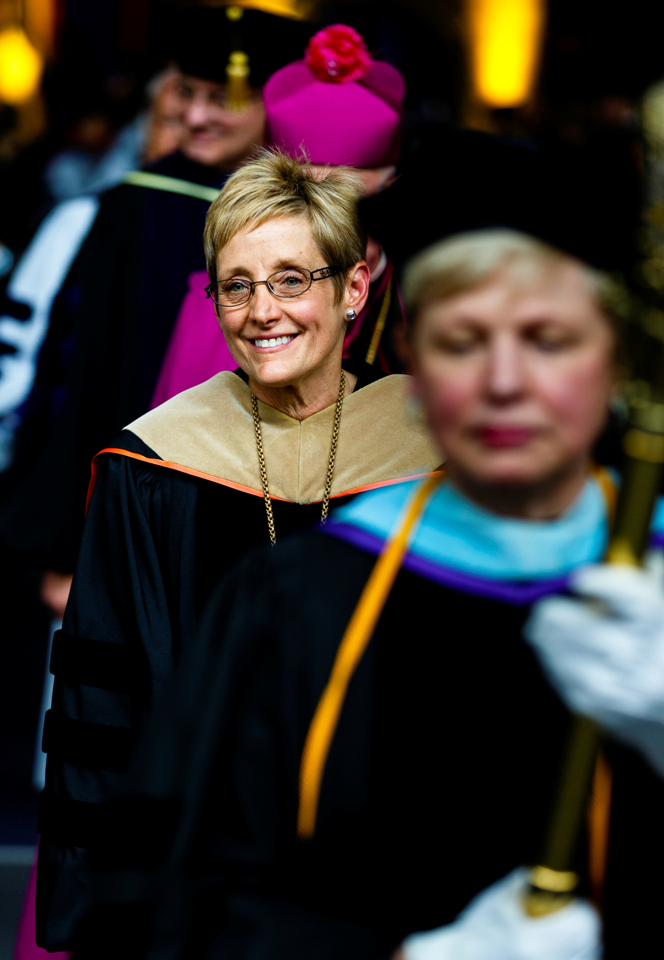 President Julie Sullivan is all smiles as she processes out of the Anderson Athletic and Recreation Complex field house following her inauguration. (Photo by Mike Ekern '02)