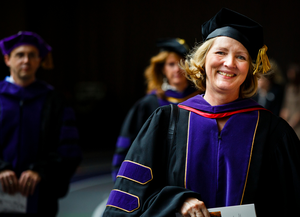 School of law Professor Teresa Collett enters the Anderson Athletic and Recreation Complex Field House during the processional. (Photo by Mark Brown)