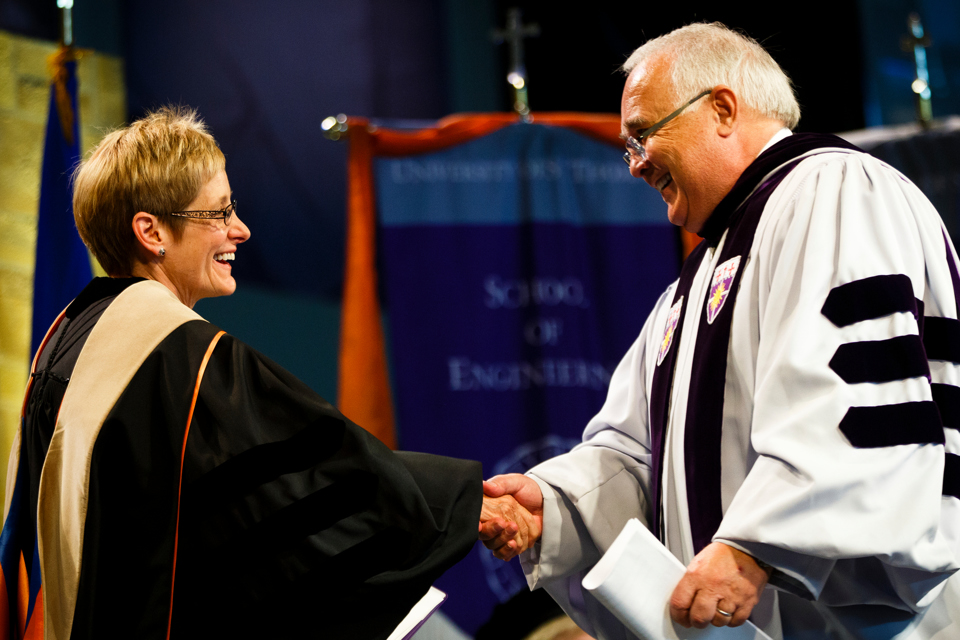 President Julie Sullivan shakes hands with trustee Ron Fowler. (Photo by Mark Brown)