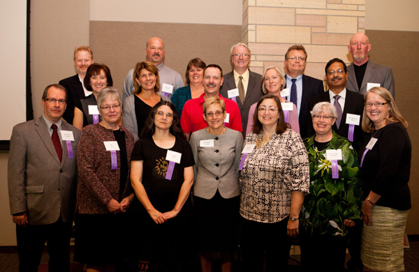 Top row, from left to right: Paul Provost, Minneapolis Campus Bookstore; Richard Lucius, Telecommunications; Lisa Dochniak, O'Shaughnessy-Frey Library; David Vang, Finance; Paul Strickland, Career Development Center; Jim Vincent, Economics. Middle row, from left to right: Mary Reichardt, Online Education; Lisa Burke, Opus College of Business Technology; Jim Waska, Campus Mail Services; Ann Johnson, Faculty Development Center; Bhabani Misra, Graduate Programs in Software. Bottom row, from left to right: David Jenkins, Saint Paul Seminary School of Divinity Music Ministry; Pat Sirek, President's Office; Cathy Lutz, O'Shaughnessy-Frey Library; President Julie Sullivan, Brenda Ambe, Opus College of Business Records and Data Management; Sandra Menssen, Philosophy; Monica Dobihal, Physical Plant.