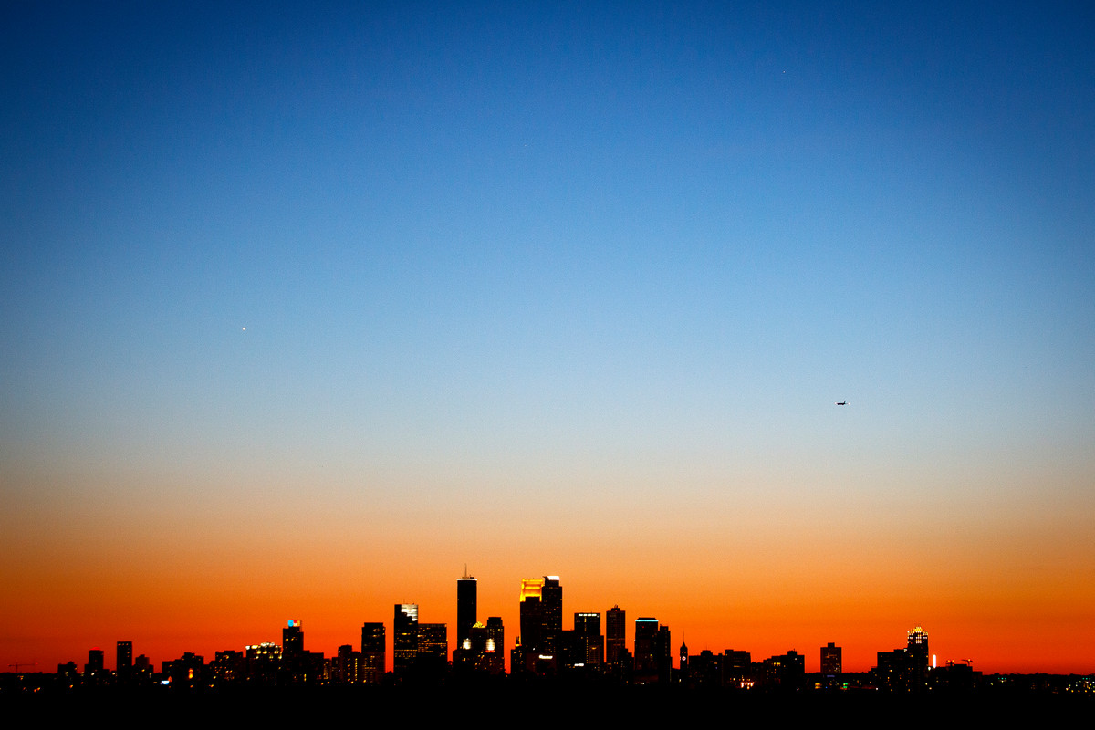 The Minneapolis skyline is seen at sunset from the roof of the Anderson Student Center. (Photo by Mike Ekern '02)