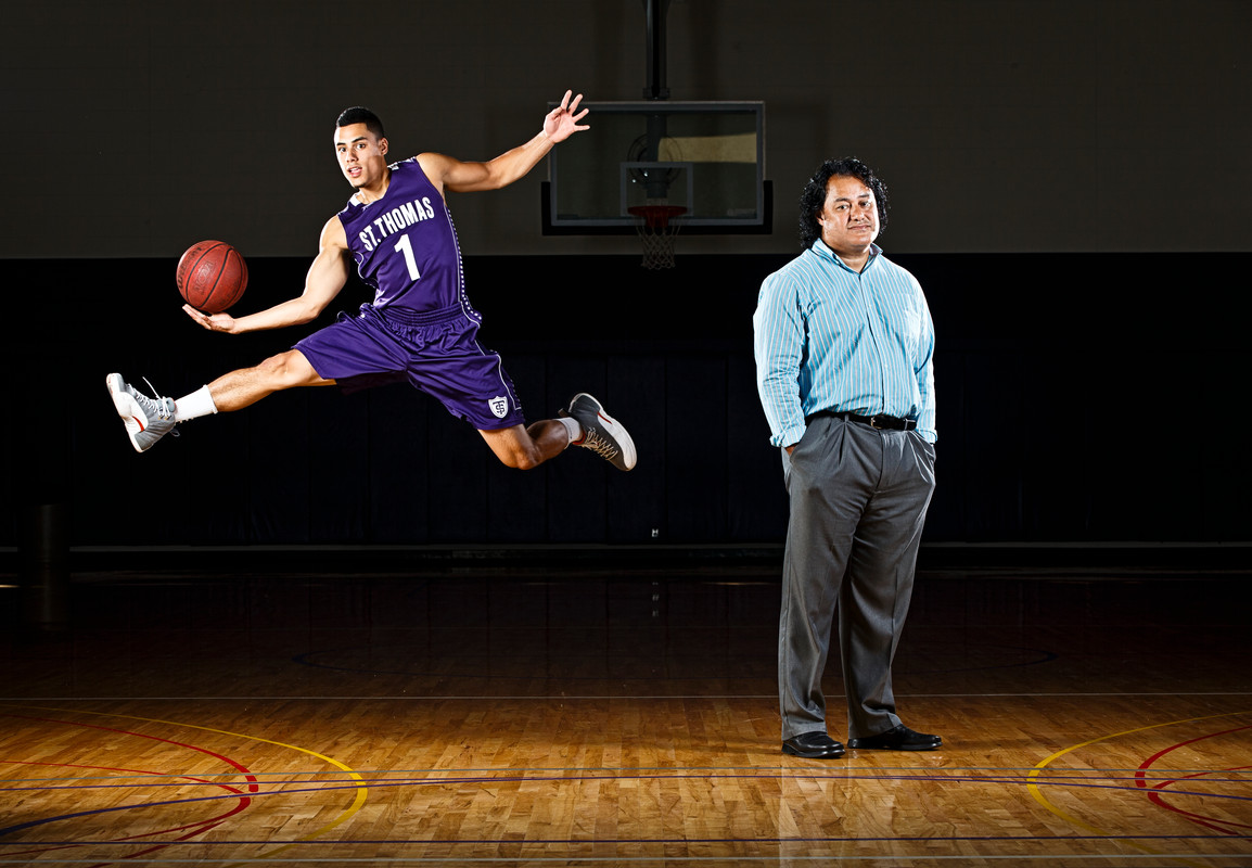Marcus Alipate (left) and his father, Tuineau, are just one set of athletic relatives on campus. Marcus is a starting point guard for the Tommies basketball squad. Tuineau was born in Tonga and played football in the NFL and Canadian football league. (Photo by Mark Brown)