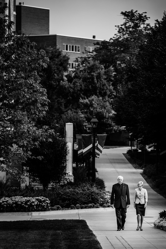 President Julie Sullivan and President Emeritus Father Dennis Dease walk together across the lower quad Aug. 19. (Photo by Mike Ekern '02)