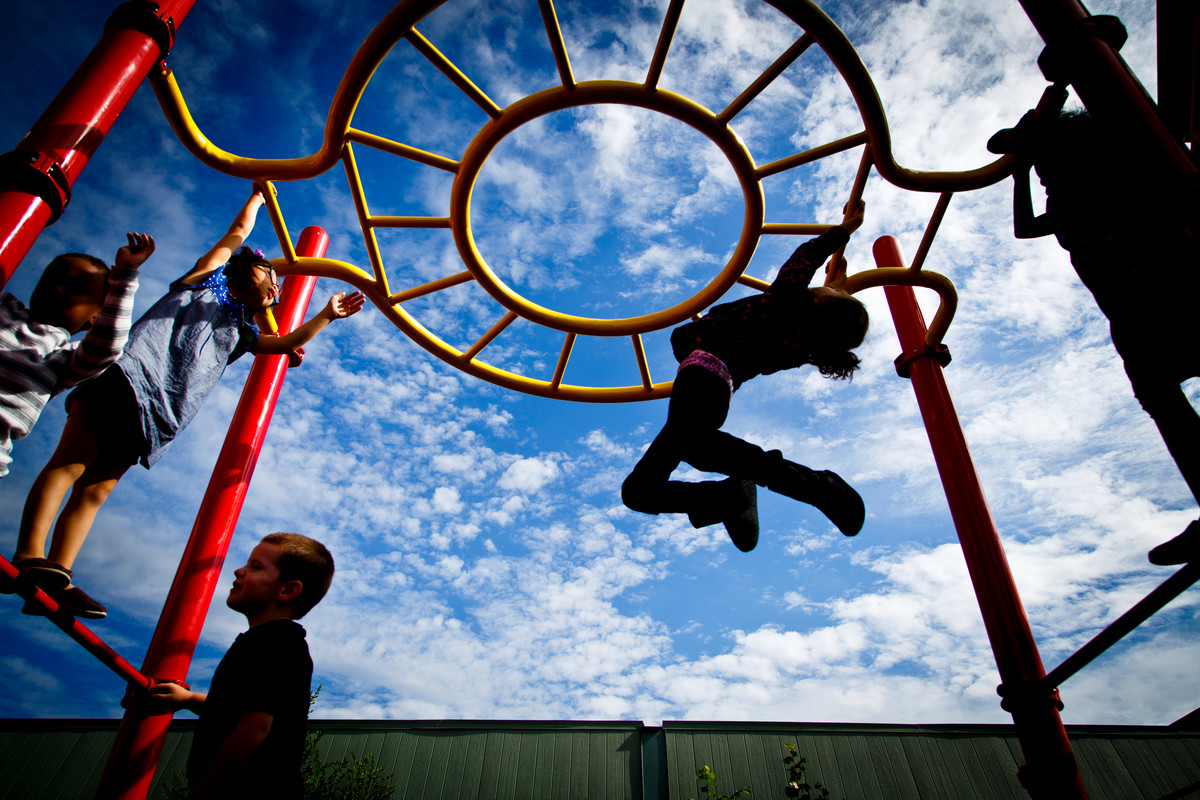 Grade school students play during recess at the Metro Deaf School in St. Paul on Oct. 2. In July, the school, believed to be the second-oldest charter school in the nation, became UST's seventh charter school. (Photo by Mark Brown)