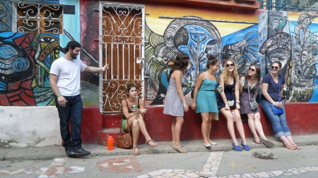St. Thomas students Peter Scheerer, Kristin Braden, Grace Burmeister, Marissa Alliegro, Laura Landvik, Sam Carlson and Liz Jagerson take a break from their stroll down Callejón de Hamel, a short, colorful street in Havana known for its eclectic arts and music scene.