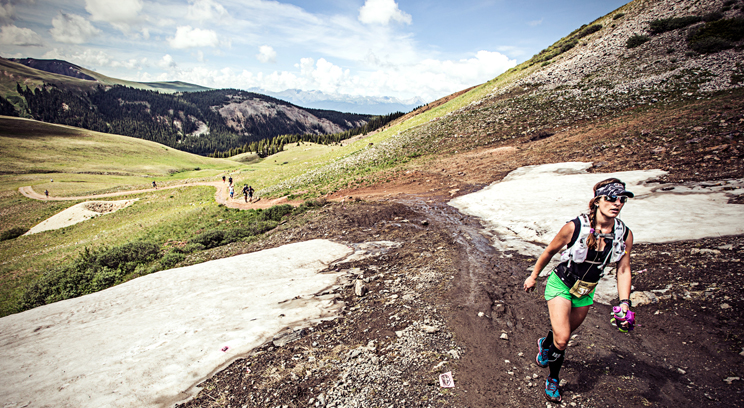 Kurhajetz climbs a mountain on the Silver Rush 50 course in July. Photo by Glen Delman.