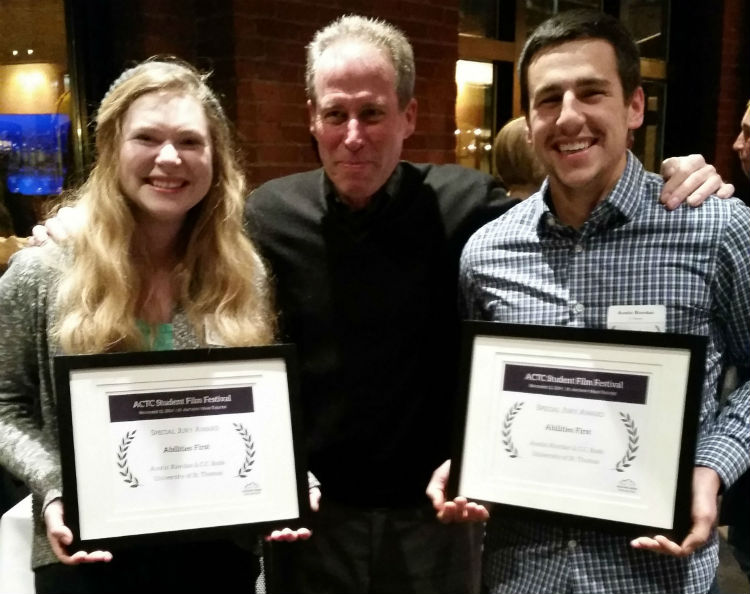 Caroline Rode (left) and Austin Riordan (right) stand with retired St. Thomas Communications and Journalism professor Tim Scully after receiving awards at the Associated Colleges of the Twin Cities Student Film Festival. (Photo courtesy of Austin Riordan)