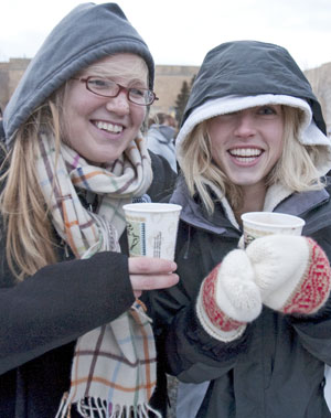 Students warming up with hot chocolate at the tree-lighting ceremony six years ago.