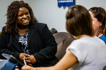 Law professor Nekima Levy-Pounds laughs as she stages a scene with students during clinical rounds April 8, 2014 at the Interprofessional Center for Counseling and Legal Services.