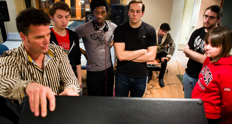 Instructor Pat Balder, left, talks about speakers during a music business class at Essential Sessions music studio in St. Paul.