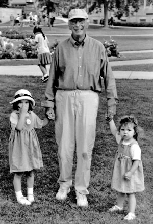 Paul Hague is pictured at the 1998 St. Thomas picnic for neighbors. With him are granddaughters Erin Rose Kessler and Emily Anne Kessler.