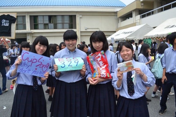 English Club students promote club events during a cultural festival. (Photo provided)