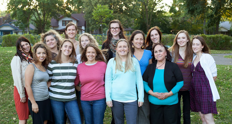 Erica Gerrity (third from left, second row) with the staff of Isis Rising. / Photo provided