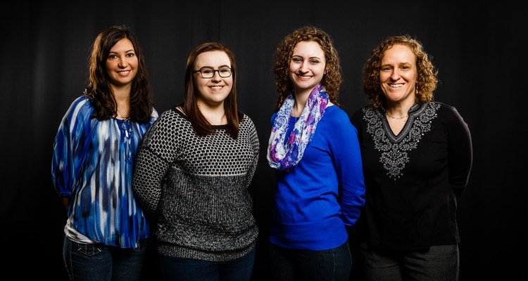 School of Social Work students (from left) Alison Paz, Lauren Olson and Claire Smart, and professor Ande Nesmith. (Photo by Mike Ekern '02)