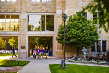 Students walk past O'Shaughnessy Science Hall and across Sabo Plaza September 14, 2015.