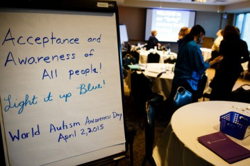 "A photo of a sign reading ""Acceptance and Awareness of All People! Light it up Blue! World Autism Awareness Day April 2, 2015"" is shown during a meeting of the College of Education, Leadership and Counseling Special Education advisory board March 4, 2015 in Terrence Murphy Hall."