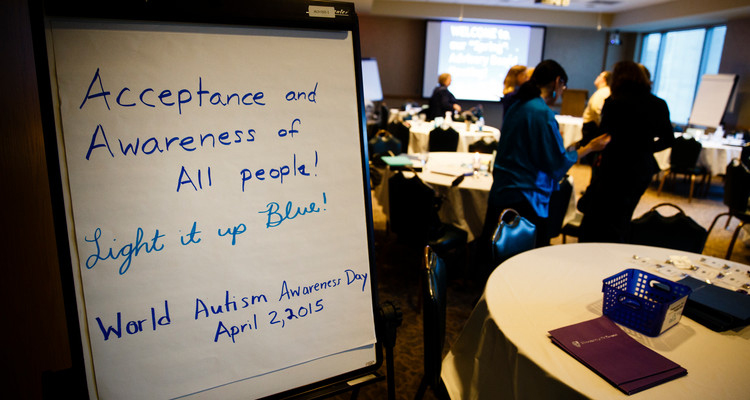 """A photo of a sign reading """"Acceptance and Awareness of All People! Light it up Blue! World Autism Awareness Day April 2, 2015"""" is shown during a meeting of the College of Education, Leadership and Counseling Special Education advisory board March 4, 2015 in Terrence Murphy Hall."""