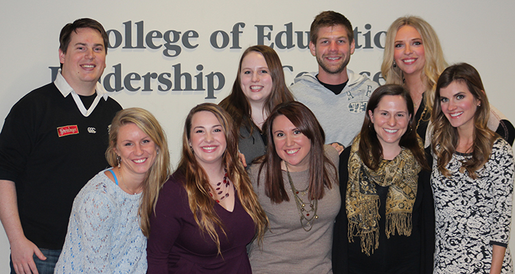 Graduate School of Professional Psychology Student Organization poses after receiving CELC's Common Good award. They are led by president Emily Erickson (first row; second from right)
