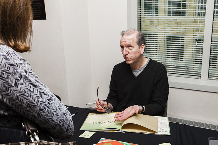 Author David Weisner signs books at the 23rd annual Hubbs Children's Literature Conference.