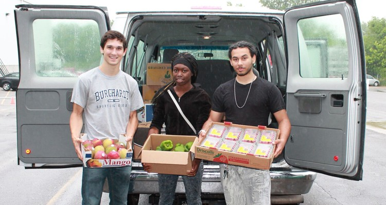 St. Thomas student Parker Hewes (left) stands with DeDe Fuller and Adam Pruitt, two high school students who work for Brightside Produce.