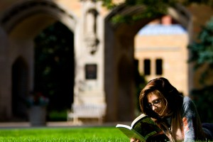 A girl reads a book with the arches in the background September 26, 2006.Campus scene St. Paul Summer