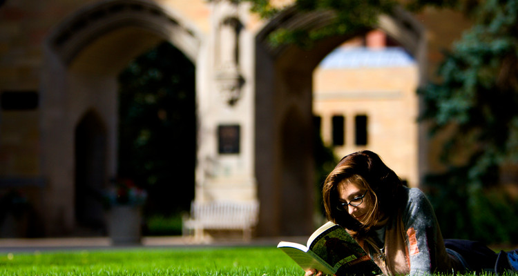 A girl reads a book with the arches in the background September 26, 2006.