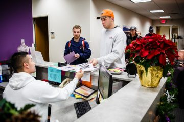 Students hand in registration forms after a job and internship fair orientation event at the Career Development Center's in the Murray-Herrick Campus Center on December 15, 2014. Students attended the event to learn about and register for the spring Job and Internship Fair.
