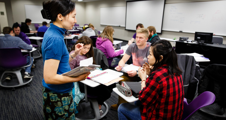 History Professor Patti Kameya talks with students during an East Asian Civilizations class in a classroom in the Murray-Herrick Campus Center (MHC) in St. Paul. Undergraduate students are required to take at least one history class before they graduate.