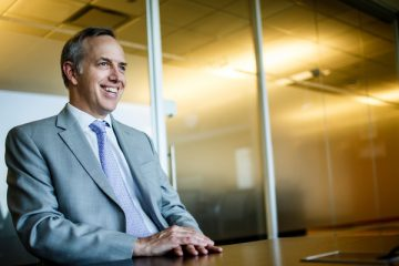 University of St. Thomas Trustee Brian Wenger, executive vice president and chief legal officer of Optum, talks during a trustee profile interview on August 3, 2015, in his office in Eden Prairie.