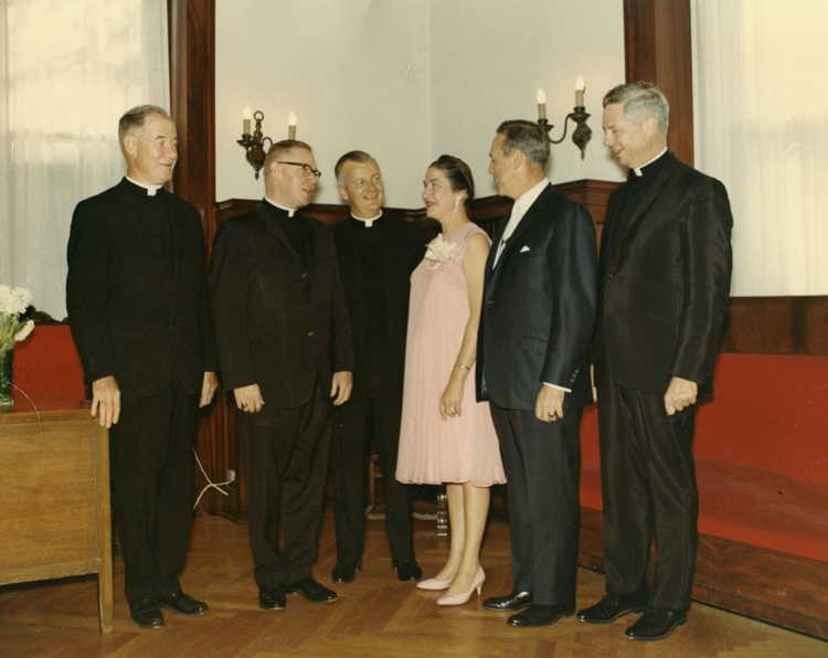 William J. Quinn '33, second from right, and his wife Floy met with St. Thomas administrators in the early 1960s. From left to right are Monsignor William O'Donnell, dean of the college; Monsignor James Shannon, president; Monsignor Terrence Murphy, executive vice president (who succeeded Shannon as president in 1966 and served in that position for 25 years); the Quinns; and Monsignor Henri DuLac, who taught philosophy.