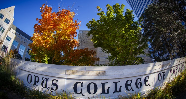 """Schulze Hall and a tree with colorful leaves are pictured with the """"Opus College of Business"""" sign and downtown skyscraper on a fall day in Minneapolis on October 10, 2014."""