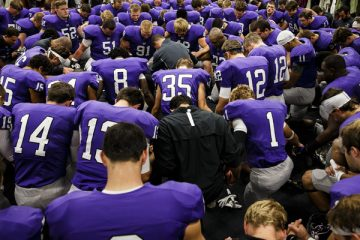 The UST football team huddles and prays in the Anderson Athletic and Recreation Center prior to the start of the Tommie-Johnnie football game on September 21, 2013, at Palmer Field in O'Shaughnessy Stadium in St. Paul. UST lost to St. John's University 20-18.