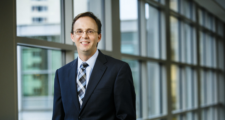 Law School Professor Joel Nichols poses for a portrait in a skyway connected to the School of Law building in downtown Minneapolis on November 17, 2015.
