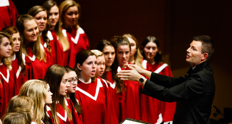 Conductor Aaron Brown leads the Liturgical Choir during a dress rehearsal for the St. Thomas Christmas Concert December 6, 2015 at Orchestra Hall in Minneapolis.