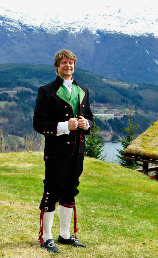 Larsen wears a traditional Norwegian bunad from his ancestors' region of Stavanger during a taping of Alt for Norge.