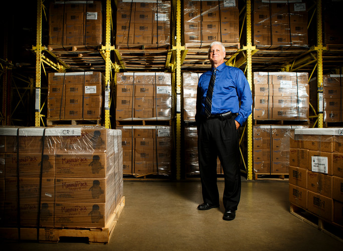 Mark Crea (Business, Economics '78), executive director and CEO of Feed My Starving Children, is pictured in the warehouse of the nonprofit's headquarters in Coon Rapids on July 19, 2013. Photo by Mark Brown.