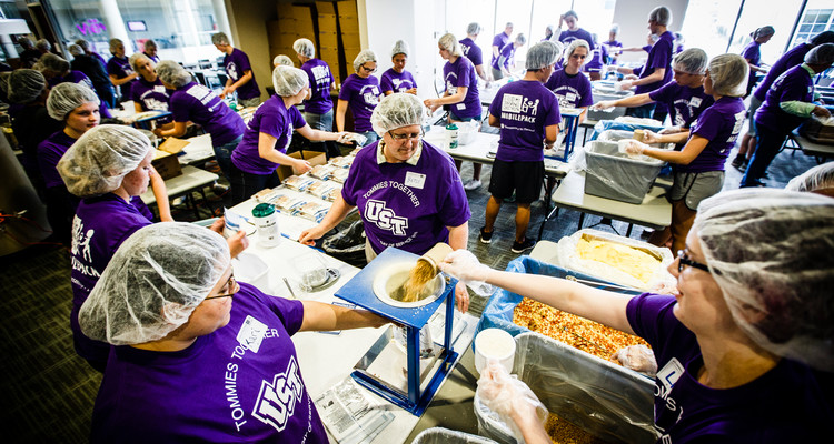 Volunteers bag up prepared meals during the St. Thomas Day of Service mobile pack event May 6, 2015 in the Anderson Student Center's Campus Way. Feed My Starving Children brought mobile supplies to St. Thomas where faculty, staff and student volunteers packed thousands of meals for children without food overseas.