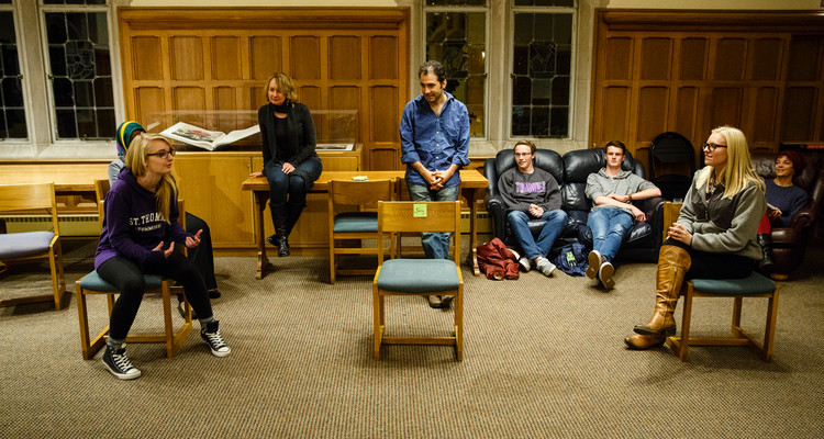 Students act in an improv exercise during an English class in the Leather Room in the O'Shaughnessy-Frey Library Center on October 28, 2015. Members of the Wonderlust Theater participated in a residency on campus with several different classes and programs, working with English and Theater students on improvisation skills and script writing. English professor Amy Muse, back right, and Wonderlust Theater co-Artistic Director Alan Berks, middle back (wearing blue shirt) look on.