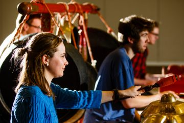 Students practice playing Gamelan, a traditional Indonesian style of music. (Photo by Mike Ekern '02)