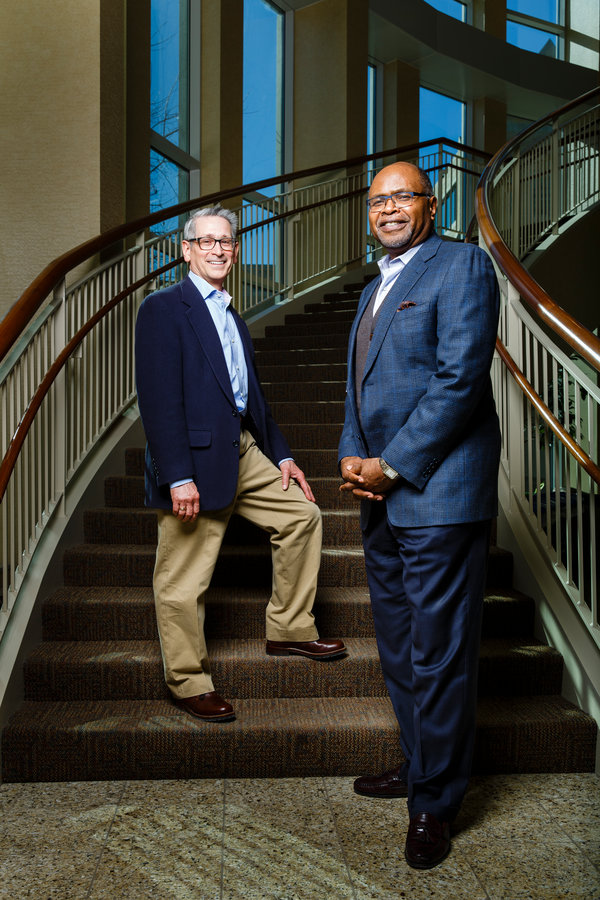 Douglas Jondle, left, research director at the Center for Ethical Business Cultures at the University of St. Thomas (CEBC) and Ron James, right, president and CEO of CEBC, pose for a portrait in Schulze Hall on March 1, 2016 in downtown Minneapolis.