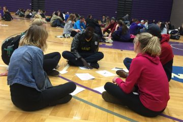 Students talk in their small groups at the World Cafe event. (Photo provided)