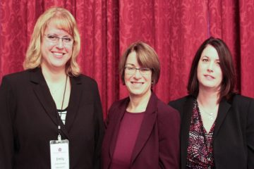 Masters in Social Work alumni Emily Alewine '08 (left) and Rachel Wolstand '93 stand with Sen. Amy Klobuchar in Washington D.C.
