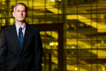 Newly appointed Dean of the University of St. Thomas School of Law Robert Vischer poses for a portrait in front of the Law School at dusk on November 20, 2012, in downtown Minneapolis. Vischer was photographed for St. Thomas Lawyer Magazine.